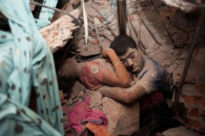 An embracing couple found in the mess of a collapsed factory.