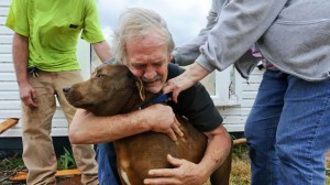 An Alabama Tornado in March 2012 brings this photo of man hugging his dog Coco. He found her inside after his home was destroyed.
