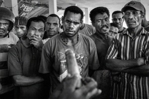 The a first for everything. In Papua, a public demostration of how to use a condom leaves everyone with a funny face.