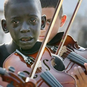 Diego Frazão Torquato, 12 year old Brazilian playing the violin at his teacher's funeral. The teacher had helped him escape poverty and violence through music