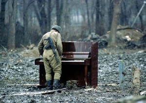 A Russian soldier playing an abandoned piano.