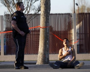 This picture captures a young man finding out his brother was just killed.